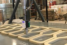 The world's first 3D printed reinforced concrete bridge starts to take shape